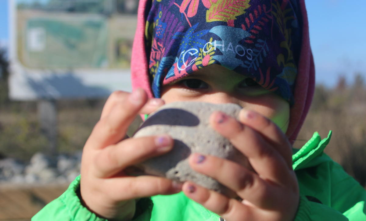 Child holding rock. Photo courtesy Tanya Leary