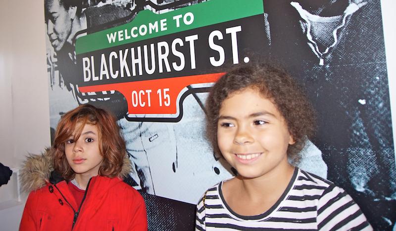 Kids standing in front of Blackhurst street sign