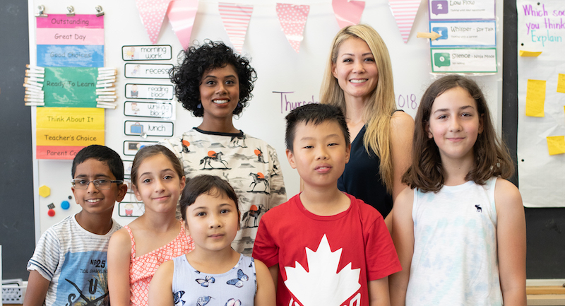 Students and teachers in front of class. Photo by Christine Cousins