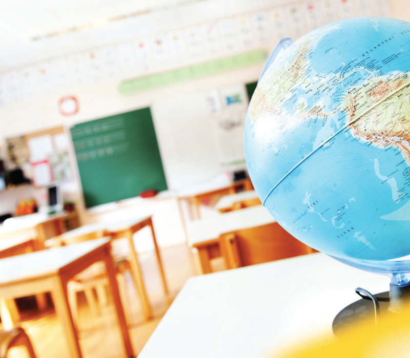 World globe sitting on desk in classroom