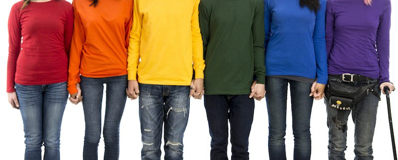 students wearing different colour shirts holding hands