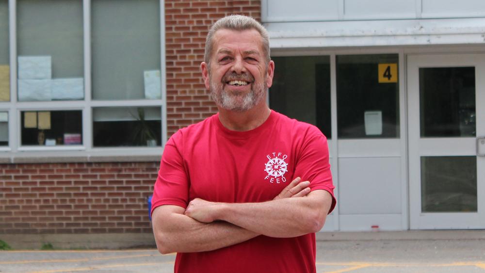 Sam Hammond posing outside of school