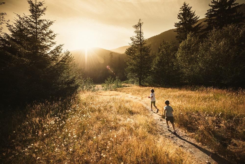 Children running outside in forest