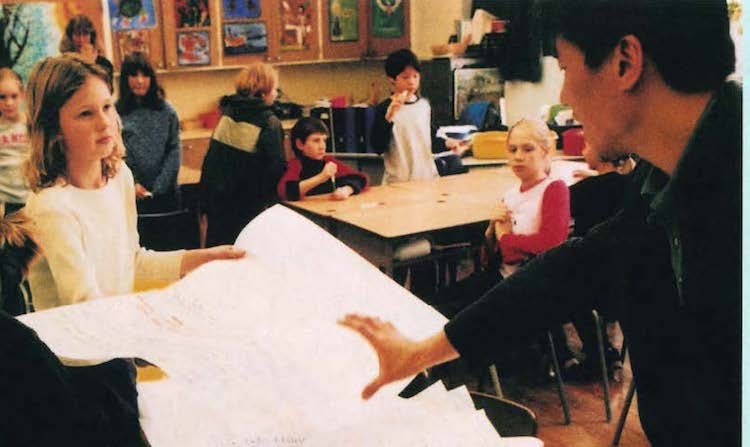 indigenous teacher in front of classroom