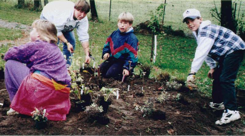 elementary students working in garden