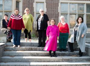 volunteers standing outside of Women's Literacy Program in Durham