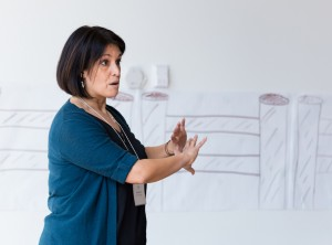 woman presenting at front of class