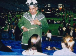 An elder talks with students in the stands at last year's Canadian Aboriginal festival