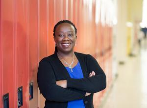 Natasha Henry standing in front of lockers