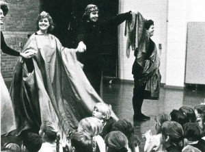 cast of play bowing in front of happy children