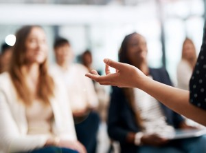 Woman speaking to classroom full of women
