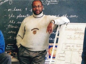 3 male teachers standing in classroom
