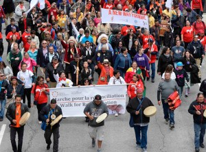 Aboriginal community members marching down street