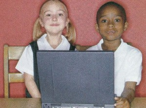 kids sitting at laptop
