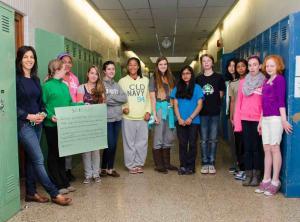 teacher and students standing in hallway between lockers