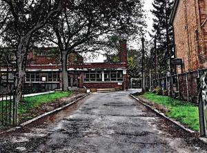 Photo of school with road in foreground and heavy HDR post-editing