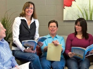 Teachers sitting together with books