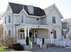 two story house with white siding