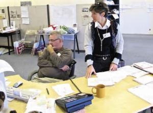 etfo staff or volunteers sorting papers in office
