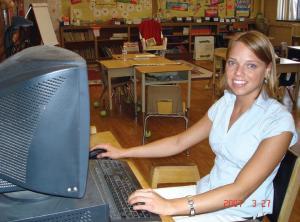 Teacher using computer in classroom