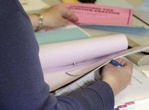 closeup of teacher flipping through book
