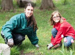 teacher and student working in garden