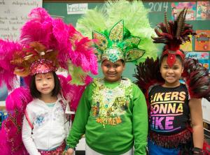 Young elementary students wearing Caribana style headwear
