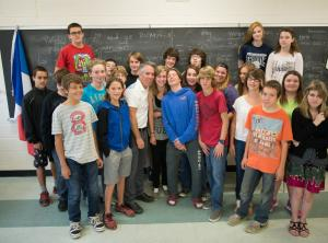 Group of elementary students standing together at front of classroom
