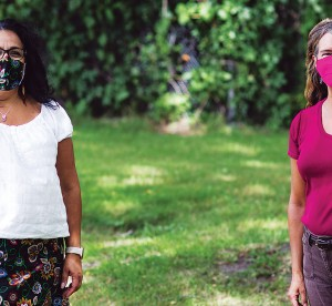 Jennifer Baron and Towana Brooks standing outside wearing masks while social distancing