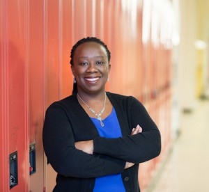 Natasha Henry standing in front of lockers