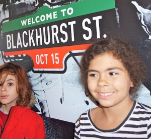 Kids standing in front of Blackhurst street sign