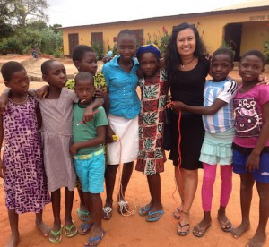 Teacher standing with Ghana students