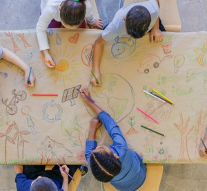 children drawing on paper