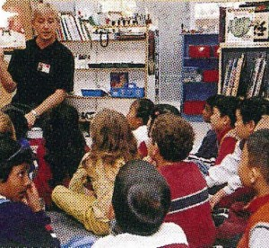 teacher reading to children in classroom