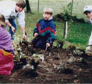 elementary students working in garden