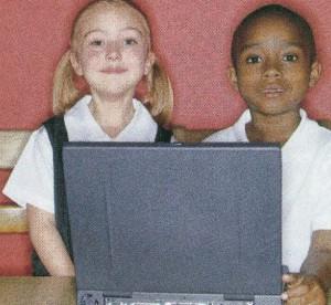 kids sitting at laptop