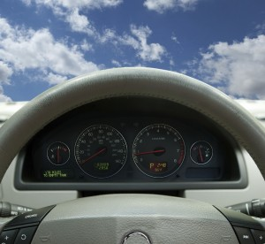 stock photo of car interior from perspective of driver with blue sky