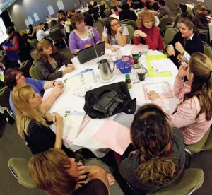 fisheye photo of etfo members sitting around a round table at the annual meeting