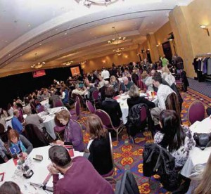 fisheye photo of etfo members sitting around round tables at annual meeting