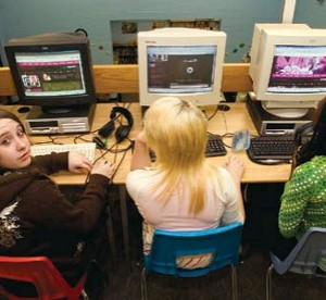 students sitting in computer lab working on computers