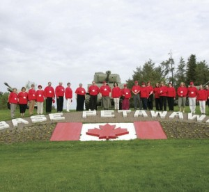 ETFO members wearing red posing next to Base Petawawa sign