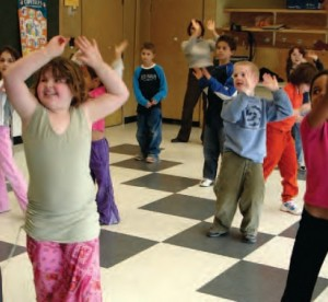 children dancing and playing in classroom