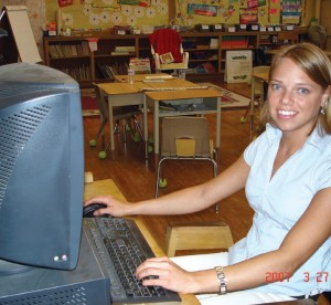 Teacher using computer in classroom