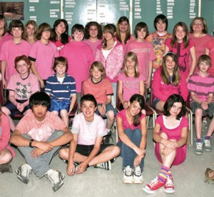 young students wearing pink posing together