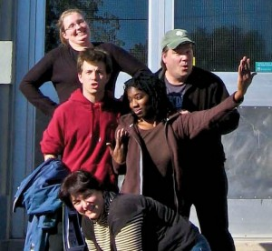 group of play actors posing outside of school