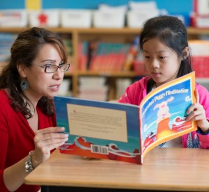 Teacher reading with elementary student