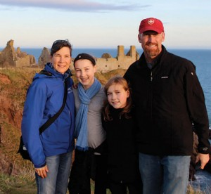 Michelle Richardson Family standing on cliff in Scotland