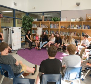 Students sitting in a circle of chairs
