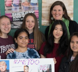 teacher and students holding up #metoo project
