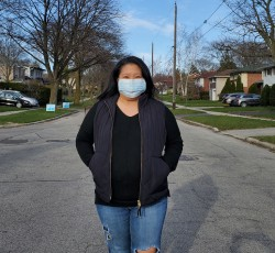 Woman standing in street wearing face mask